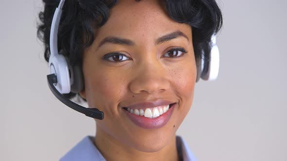 Cover Image for Smiling African American call center representative