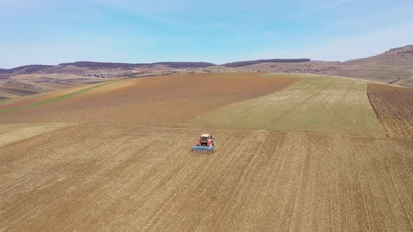 Thumbnail for Combine Plowing Agricultural Land in the Spring