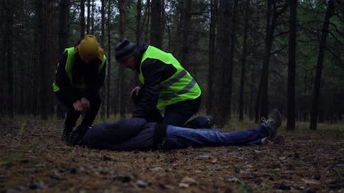 Group of Volunteers in Green Vests Went in Search of Missing Persons in a Pine Forest