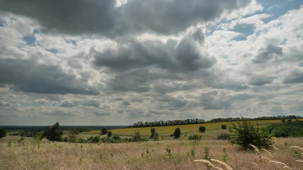Thumbnail for Landscape Dramatic Fields and Moving Storm Clouds in Blue Sky. Timelapse. Amazing Rural Valley