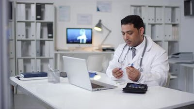 Male Physician Working Online