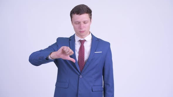 Thumbnail for Angry Young Businessman Giving Thumbs Down