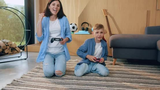 Thumbnail for Mother and Son which Sitting on the Floor and Having Fun During Playing Video Game