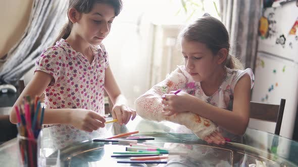 Thumbnail for Children Draw Together on a Plastered Arm in a Bandage