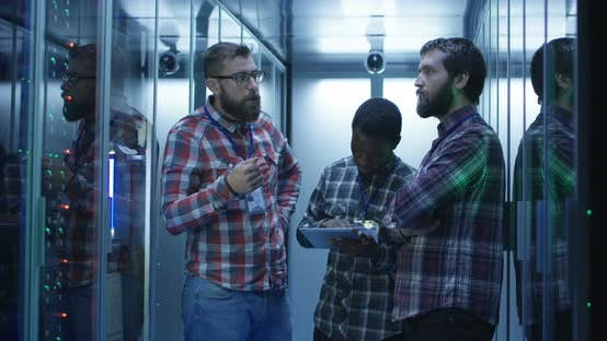Coworking IT Engineers Diagnosing Server Hardware