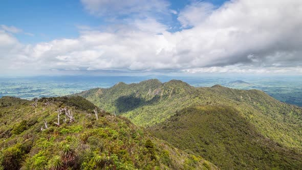 White Clouds over Sunny Forest Mountains in New Zealand Wild Nature