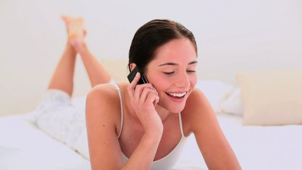 Thumbnail for Attractive Brunette Chatting On The Phone