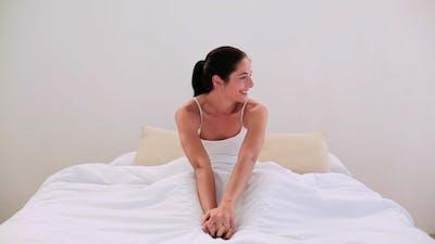 Attractive Brunette Smiling At Bedtime In Bed
