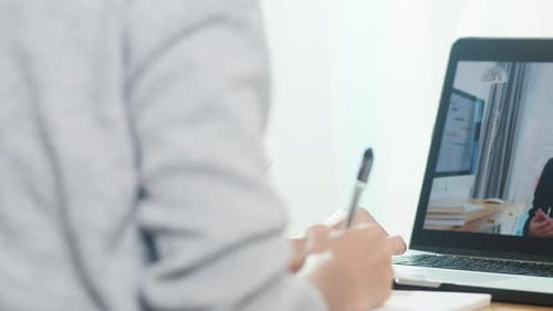 Young Asia teen girl university student using laptop computer distance learning lesson.