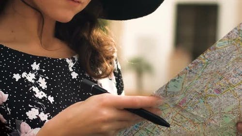 Beautiful Female Tourist Checking Map in Cafe Closeup Making Notes Tourism