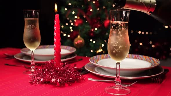Pouring Champagne on Christmas Table