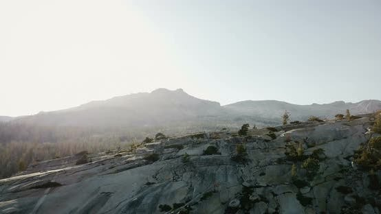 Thumbnail for Drone Flying Above Amazing White Mountain Ridge To Reveal Large Pine Forest at Summer Yosemite