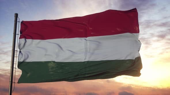 Flag of Hungary Waving in the Wind Against Deep Beautiful Sky at Sunset