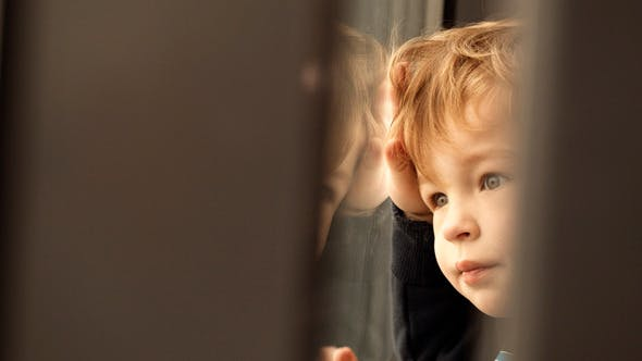 Thumbnail for Little Boy Looking Out Of The Window