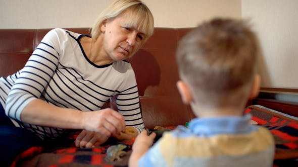 Thumbnail for Grandmother And Granson Playing With Toys