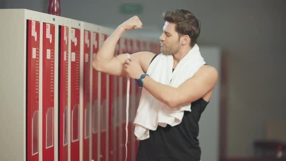Thumbnail for Happy Sportsman Satisfying with Biceps Results in Dressing Room