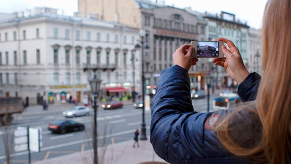 Thumbnail for Woman With Smartphone Taking Pictures Of City