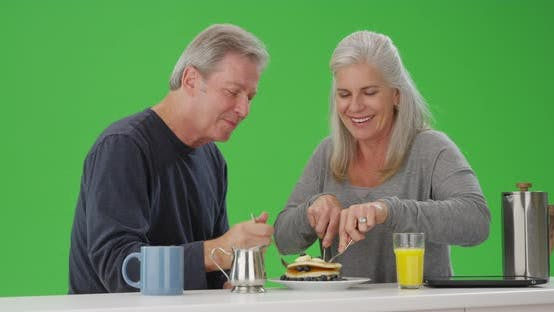 Thumbnail for Portrait of elderly couple having breakfast together