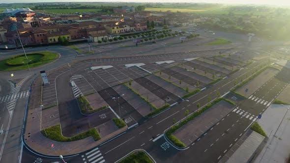 Cover Image for Drone Flying Over Parking, Checking Free Places at Outlet Village Mantova, Italy