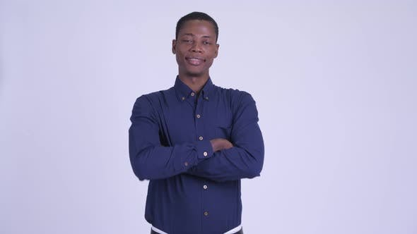 Young Happy African Businessman Smiling with Arms Crossed