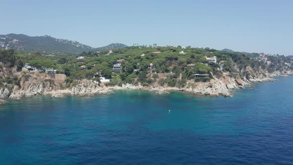 Thumbnail for Drone Flight Over Blue Sea To Rocky Coastline