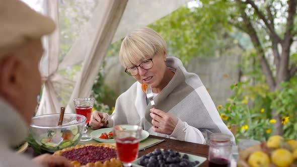 Thumbnail for Smiling Caucasian Lady Enjoying Simple Lunch with Husband Outdoors