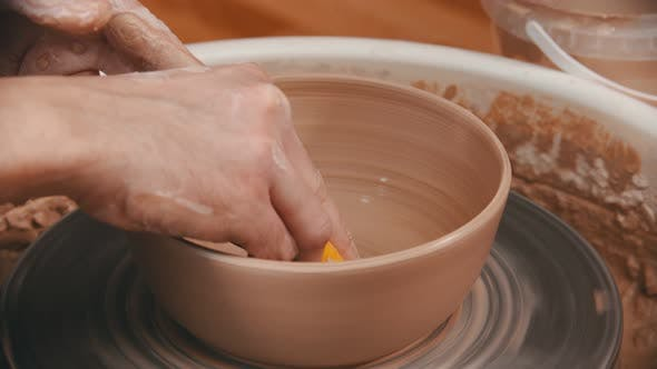 Thumbnail for Pottery - Master Is Wiping the Bottom of the Bowl with a Yellow Sponge