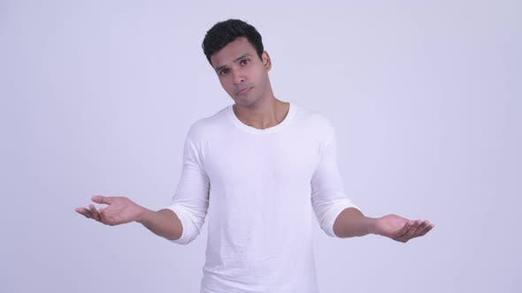 Thumbnail for Confused Young Indian Man Shrugging Shoulders