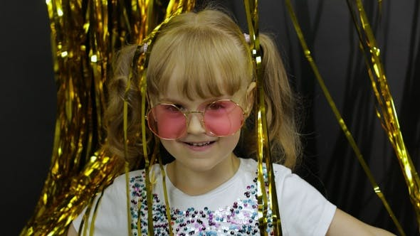 Thumbnail for Happy Child Jumping, Playing, Fooling Around in Shiny Foil Fringe Golden Curtain. Little Blonde Girl