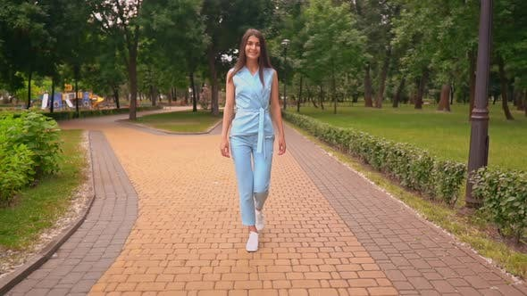 Successful Businesswoman in Blue Suit Walking in Summer City