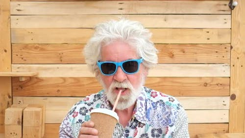 Handsome senior aged alternative diverse caucasian mature funny man in front of the camera