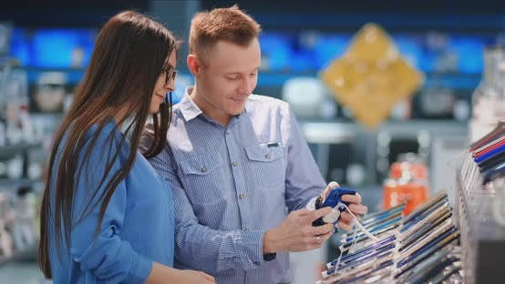 Thumbnail for Couple at Tech Store Looking for a New Mobile Phone.
