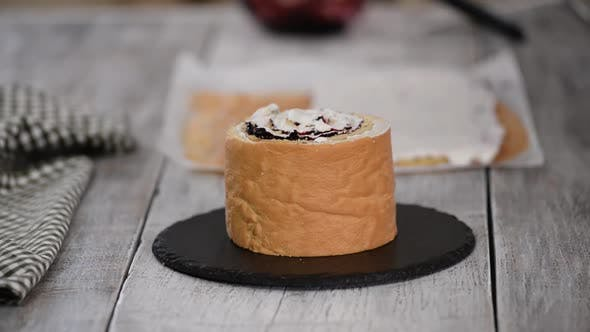 Thumbnail for Pastry Chef Making Sponge Cake with Vertical Layers and Blackcurrant Jam