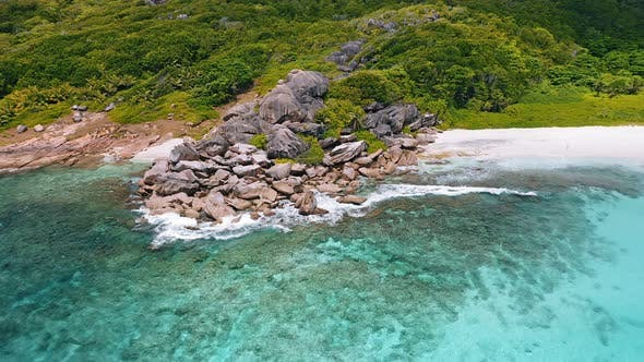 Thumbnail for Aerial View of Tropical Paradise Beach Grand Anse. Huge Rocks, White Sand Beach and Turquoise Blue