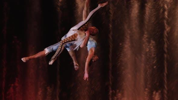 Couple performing aerial acrobatics