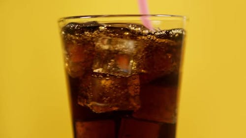 Mixing Cola Cocktail with Drinking Straw