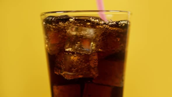Cover Image for Mixing Cola Cocktail with Drinking Straw