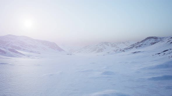 Thumbnail for Aerial Landscape of Snowy Mountains and Icy Shores in Antarctica