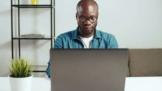 Thumbnail for Afro-american Man Working on Laptop