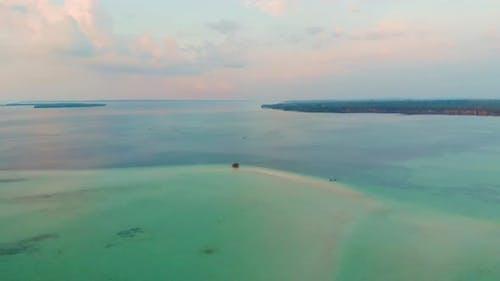 Aerial: uncontaminated coastline beach sunset at Kei Islands Indonesia