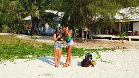Thumbnail for Ladies together enjoying life on paradise tourist beach adventure by aqua blue lagoon and white sand