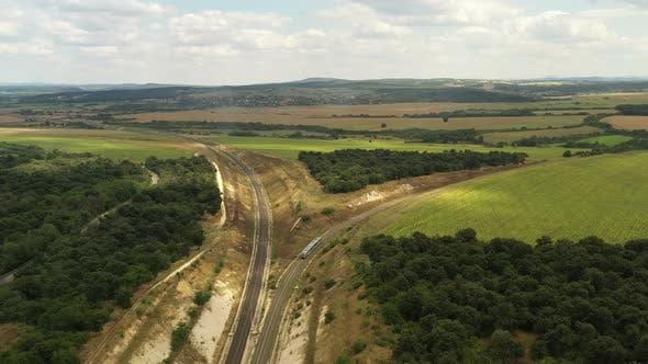 Thumbnail for Passenger Train Passes Through Beautiful Farmland