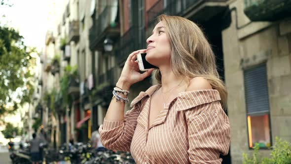 Thumbnail for Portrait of Cheerful Woman Talking Smartphone. Positive Woman Chatting Cellphone