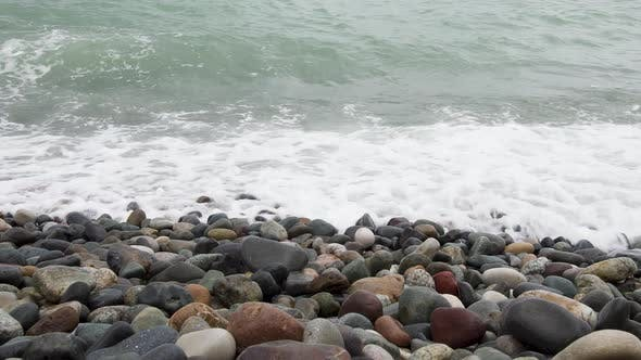 Thumbnail for Sea Waves Roll on Pebbles Shore During a Light Storm Close Up