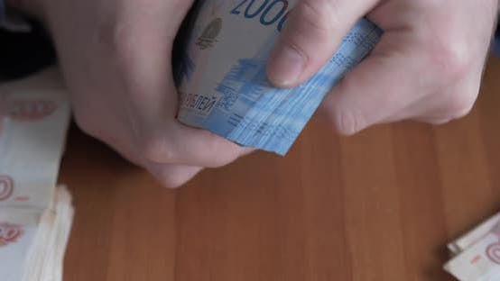 Thumbnail for Male Hands Counting Money. Russian Money Banknotes of 2,000 Rubles