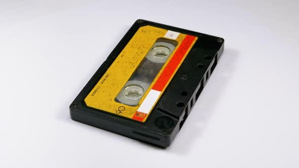 Cover Image for Audio Cassette Rotates on White Background