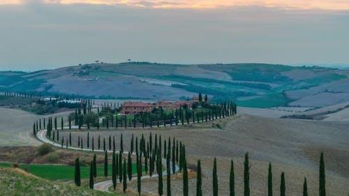 Sunrise time lapse of Tuscany landscape in Italy