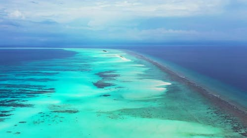 Luxury fly over island view of a sunshine white sandy paradise beach and blue water background in co