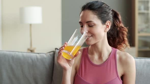 Sporty Woman Enjoying Drinking Juice