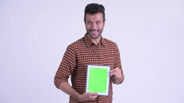 Thumbnail for Happy Bearded Persian Hipster Man Showing Digital Tablet